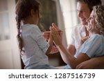 side view of a little girl... | Shutterstock . vector #1287516739