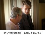 side view of two men in a... | Shutterstock . vector #1287516763