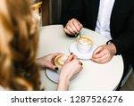 couple drink coffee | Shutterstock . vector #1287526276