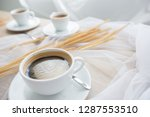 white cup of espresso coffee... | Shutterstock . vector #1287553510