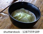 cucumber salad on wooden table | Shutterstock . vector #1287559189