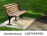 side view on a wooden park... | Shutterstock . vector #1287559990