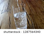 pour a glass of water | Shutterstock . vector #1287564340