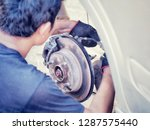 the car mechanic is checking... | Shutterstock . vector #1287575440