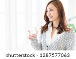 young attractive asian woman... | Shutterstock . vector #1287577063