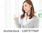 young attractive asian woman... | Shutterstock . vector #1287577069