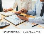 business advisor analyzing... | Shutterstock . vector #1287626746