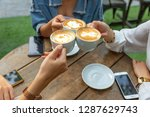 group of friends cheers with... | Shutterstock . vector #1287629743