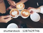 group of friends cheers with... | Shutterstock . vector #1287629746