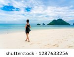 woman on beautiful tropical... | Shutterstock . vector #1287633256