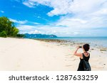 the woman on beautiful tropical ... | Shutterstock . vector #1287633259