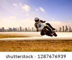 man wearing safety suit riding... | Shutterstock . vector #1287676939
