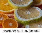 colorful fresh citrus fruit... | Shutterstock . vector #1287736483