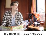 handsome guy consulting his map ... | Shutterstock . vector #1287751006