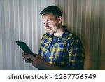 smiling employee dressed in... | Shutterstock . vector #1287756949