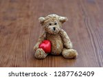 teddy bear with red heart on... | Shutterstock . vector #1287762409