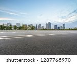 empty asphalt road with city... | Shutterstock . vector #1287765970