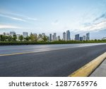 empty asphalt road with city... | Shutterstock . vector #1287765976