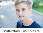 cute blond caucasian teenage... | Shutterstock . vector #1287776476