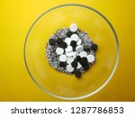 white and black pills on yellow ... | Shutterstock . vector #1287786853