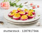 beet dyed deviled eggs. easter... | Shutterstock . vector #1287817366