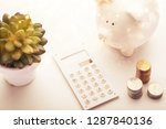 a money box and electronic... | Shutterstock . vector #1287840136