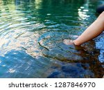 female feet splashing water in... | Shutterstock . vector #1287846970