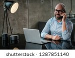middle aged designer working in ... | Shutterstock . vector #1287851140