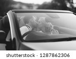 the couple traveling by car on... | Shutterstock . vector #1287862306
