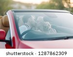 the couple traveling by car on... | Shutterstock . vector #1287862309