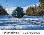 snowy landscape with railway... | Shutterstock . vector #1287993439