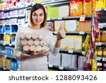 young female shopper searching... | Shutterstock . vector #1288093426