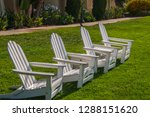 group of four white adirondack... | Shutterstock . vector #1288151620