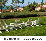 group of four white adirondack... | Shutterstock . vector #1288151800