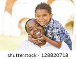 happy mixed race father and son ... | Shutterstock . vector #128820718