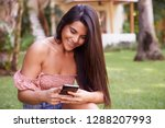 Smiling Woman On Smart Phone I...