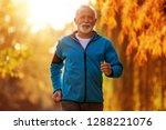 senior runner doing stretching... | Shutterstock . vector #1288221076