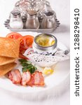breakfast with egg  bacon ... | Shutterstock . vector #1288298410