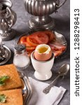 a soft boiled egg  croutons and ... | Shutterstock . vector #1288298413