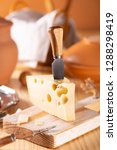 a piece of fresh tasty cheese... | Shutterstock . vector #1288298419