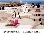 greece  santorini. restaurant... | Shutterstock . vector #1288344253