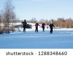 a family skiing  | Shutterstock . vector #1288348660