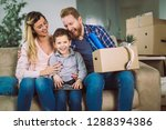 happy family with cardboard... | Shutterstock . vector #1288394386