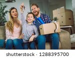 happy family with cardboard... | Shutterstock . vector #1288395700