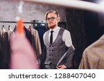 young shopaholic man chousing... | Shutterstock . vector #1288407040