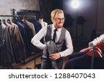 young shopaholic man chousing... | Shutterstock . vector #1288407043