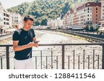 young tourist man with...   Shutterstock . vector #1288411546