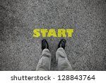 a pair of feet on a tarmac road ... | Shutterstock . vector #128843764