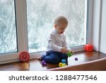 little boy with dummy sits on... | Shutterstock . vector #1288477546