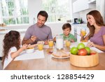 family eating healthy breakfast ... | Shutterstock . vector #128854429